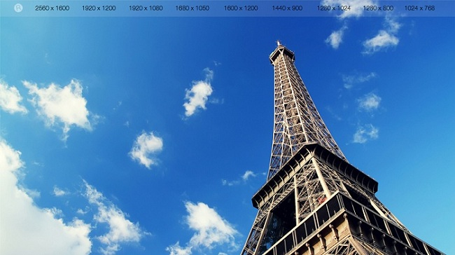 Eiffel Tower With Blue Sky And White Clouds Wallpaper
