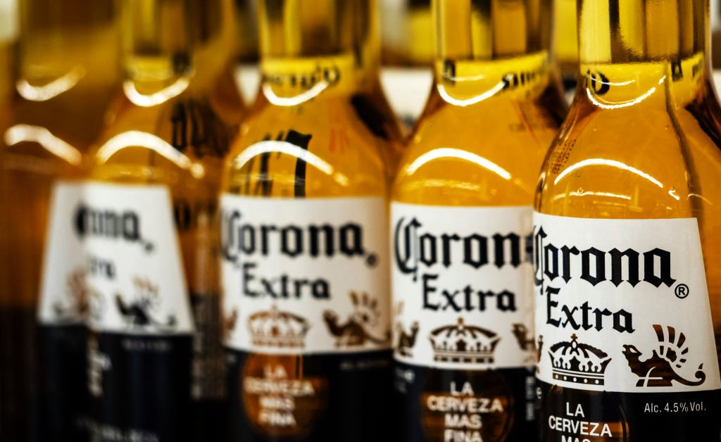 Detail of lined up Corona beer bottles seen on the store